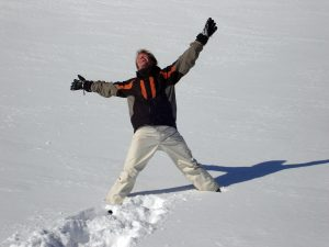 Man shows relief in snowy field
